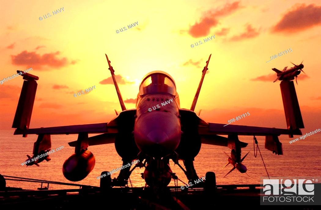 Stock Photo: At sea aboard USS John C. Stennis, December 18, 2001 - After an early morning round of flight operations, an F/A-18 Hornet awaits the next round of combat.