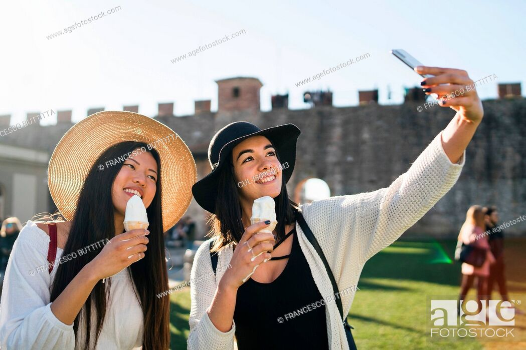 Stock Photo: Friends taking selfie with ice cream cone, Pisa, Toscana, Italy.