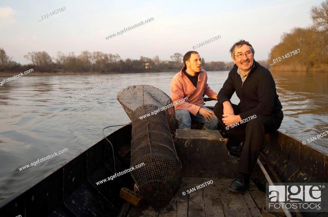 Stock Photo: Alex Faget, professional fisher, and Gérard Bossé, chef of restaurant Les Tonnelles, Rochefort-sur-Loire, Maine-et-Loire, Pays de la Loire, France.