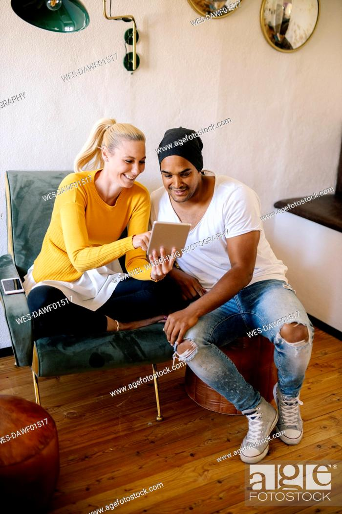 Stock Photo: Couple using digital tablet at home.