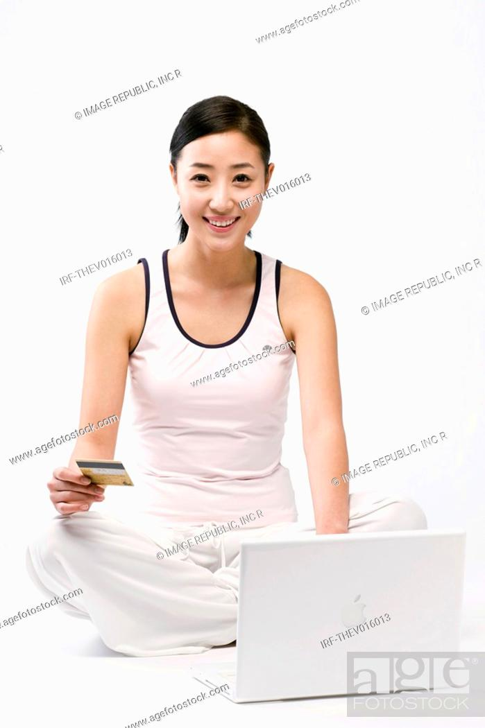 Stock Photo: woman in jim suit and laptop.