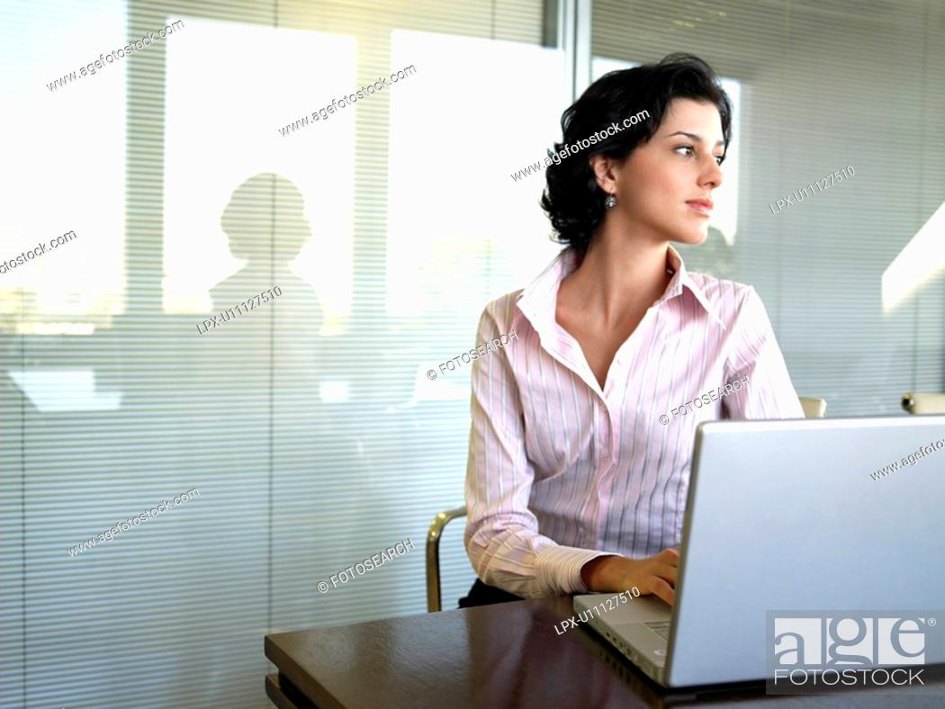 Stock Photo: Young businesswoman using laptop computer.