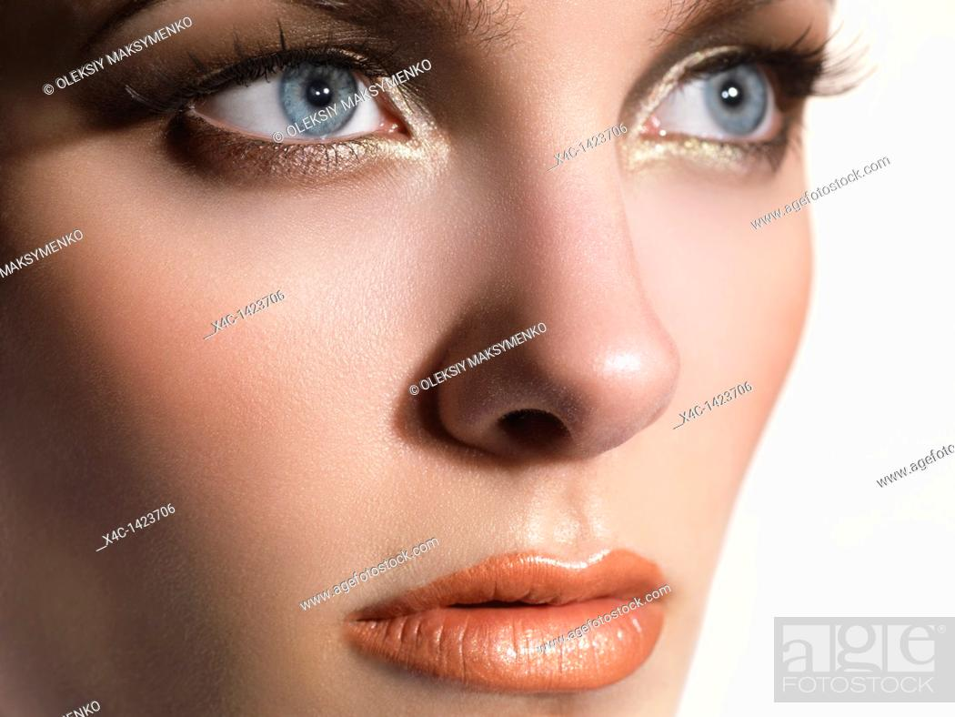 Stock Photo: Closeup portrait of a beautiful young woman's face.