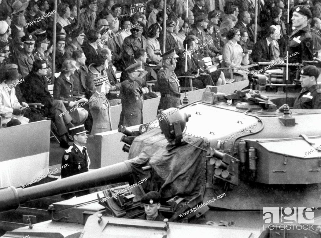 Stock Photo: British tanks driving past a VIP stand during a parade on occasion of the 'Armed Forces Day' on 18th May 1968 in Berlin. To be seen on the VIP stand are three.