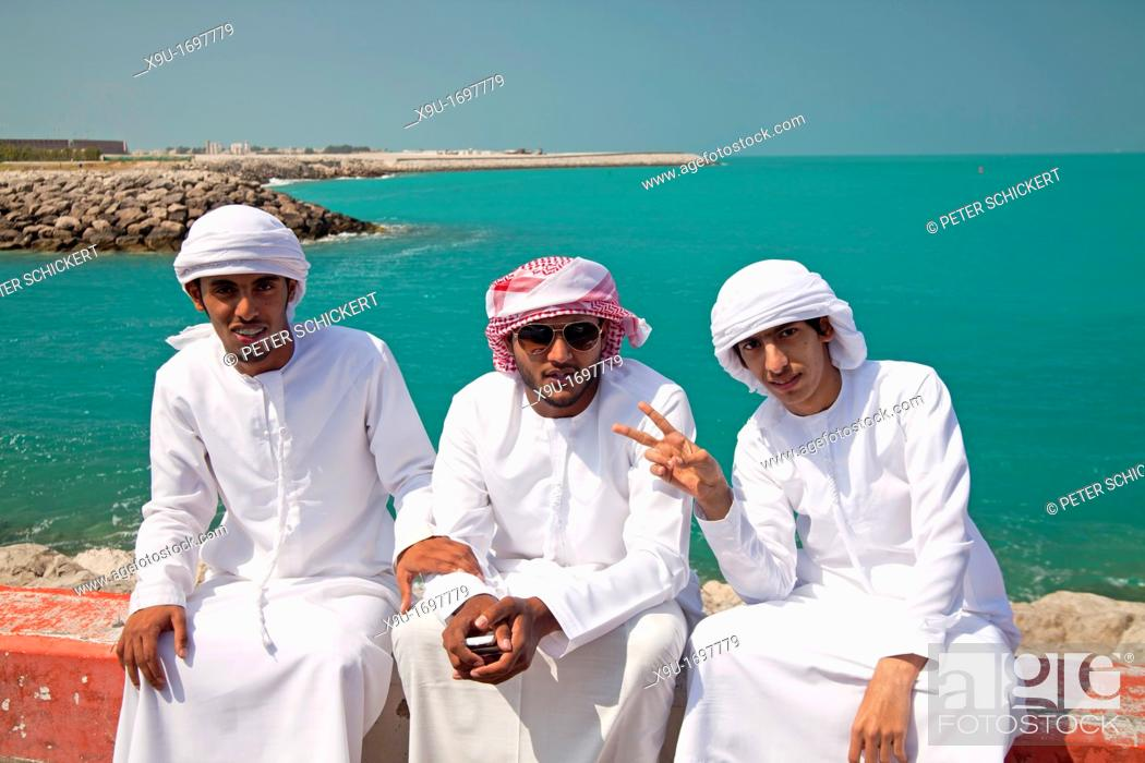 Stock Photo: young male locals with their typical traditional arabic dress Kandora or Dishdasha, Abu Dhabi, capital city of the United Arab Emirates UAE, Asia.