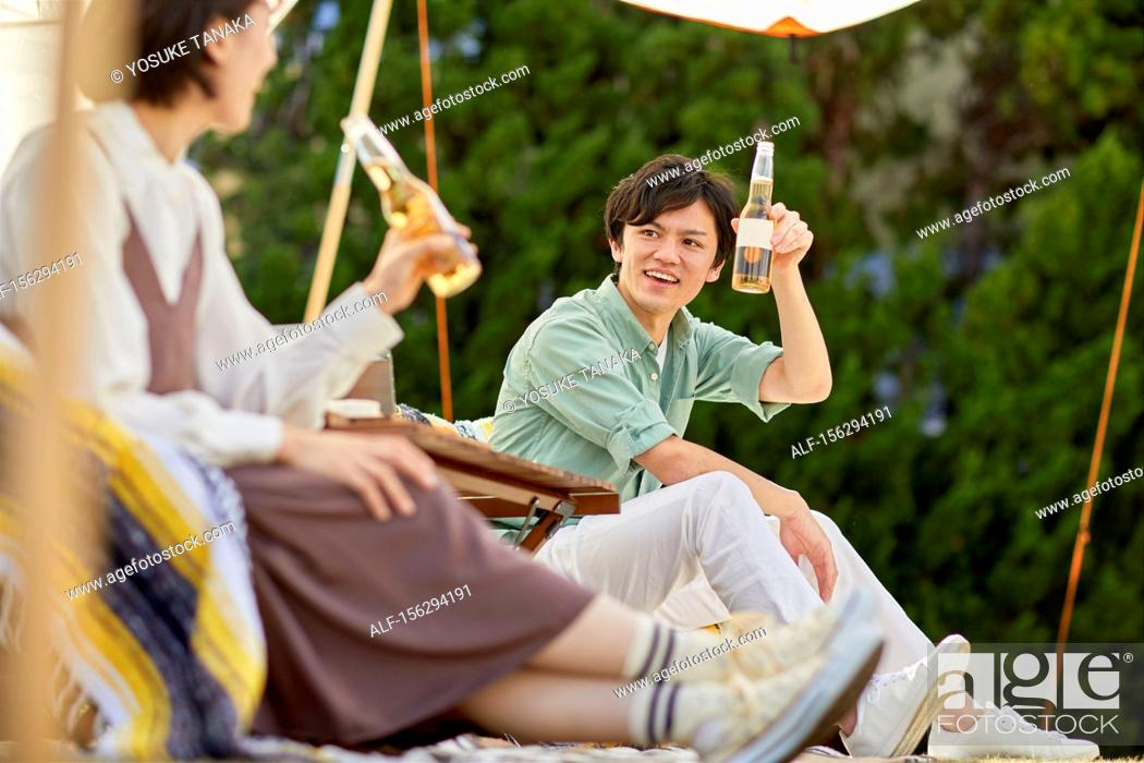 Stock Photo: Japanese friends having a party in the garden.