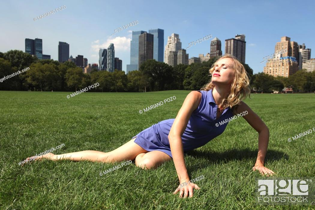 Stock Photo: Young woman poses in Central Park, New York, USA.