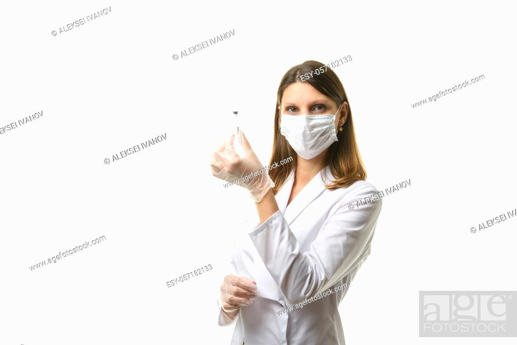 Stock Photo: Laboratory technician holds a test tube with medicine.