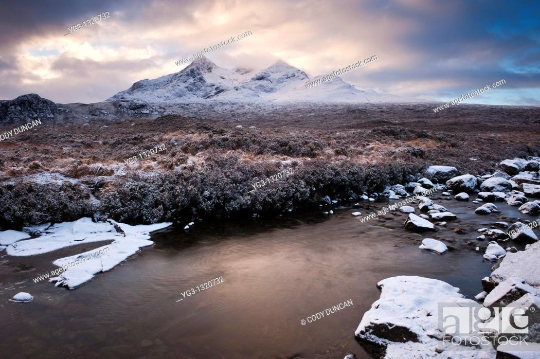 Stock Photo: Clearning winter storm over Black Cuillins, Isle of Skye, Scotland.