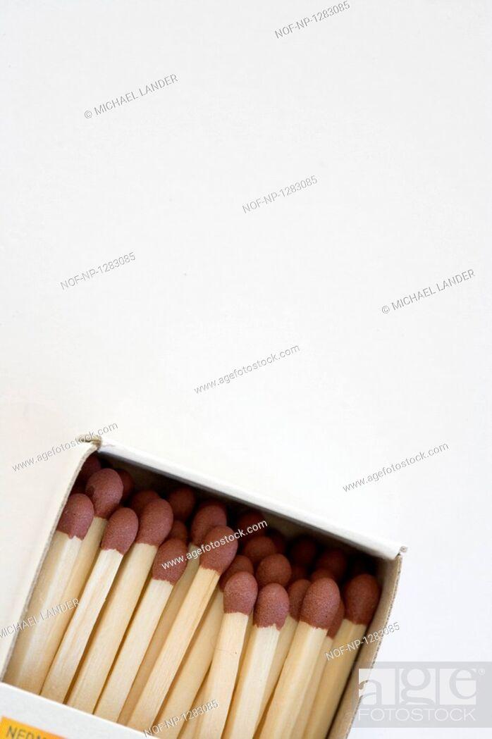 Stock Photo: Close-up of matchsticks in a matchbox.