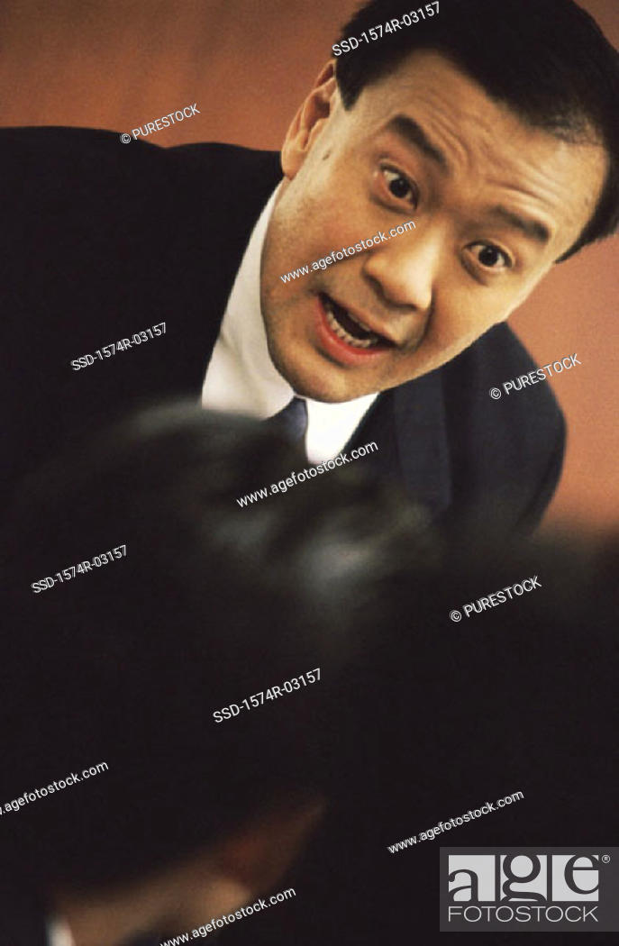 Stock Photo: Businessman talking in a meeting.