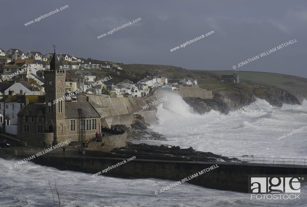 Stock Photo: PORTHLEVEN, UK - 03 Mar 2019 - Spectators watch huge waves that came in with Storm Freya amid wind gusts of around 60mph at Porthleven Cornwall England UK on 03.