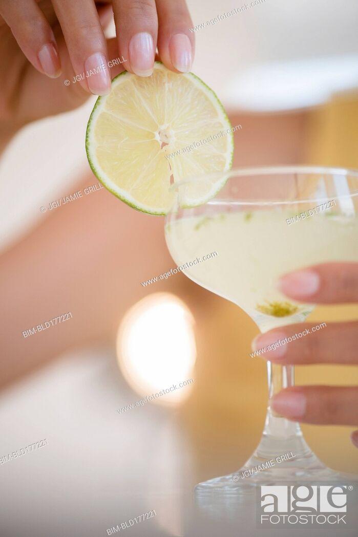 Stock Photo: Hispanic woman drinking cocktail.