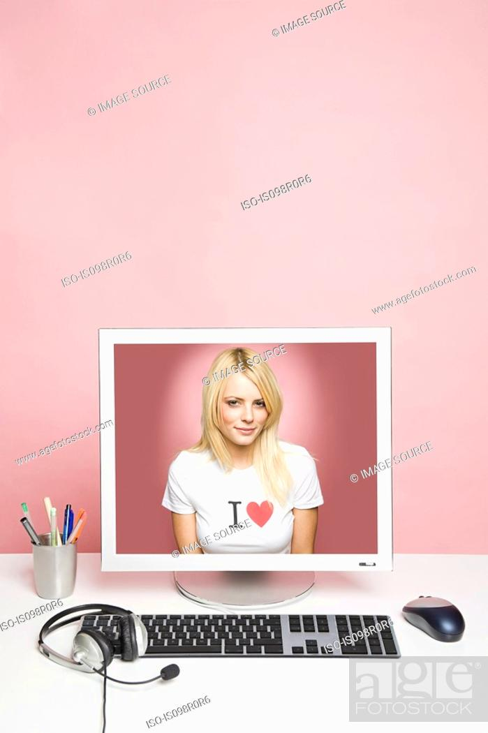 Stock Photo: A young woman on a computer.
