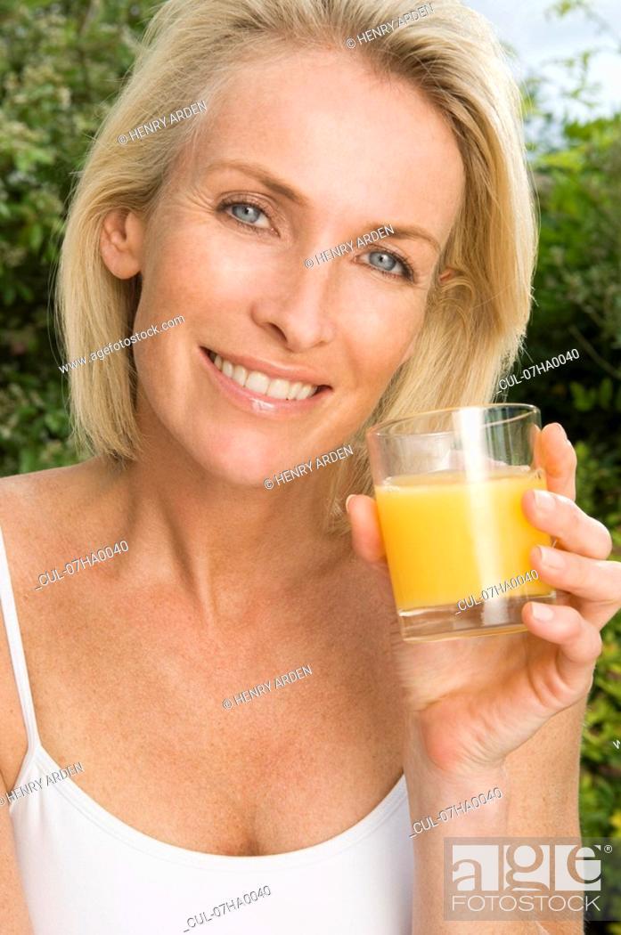 Stock Photo: Portrait of woman with orange juice.