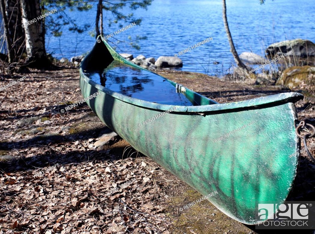Stock Photo: Canoe full of water  Location Nokisenkoski Rautalampi Finland Scandinavia Europe.