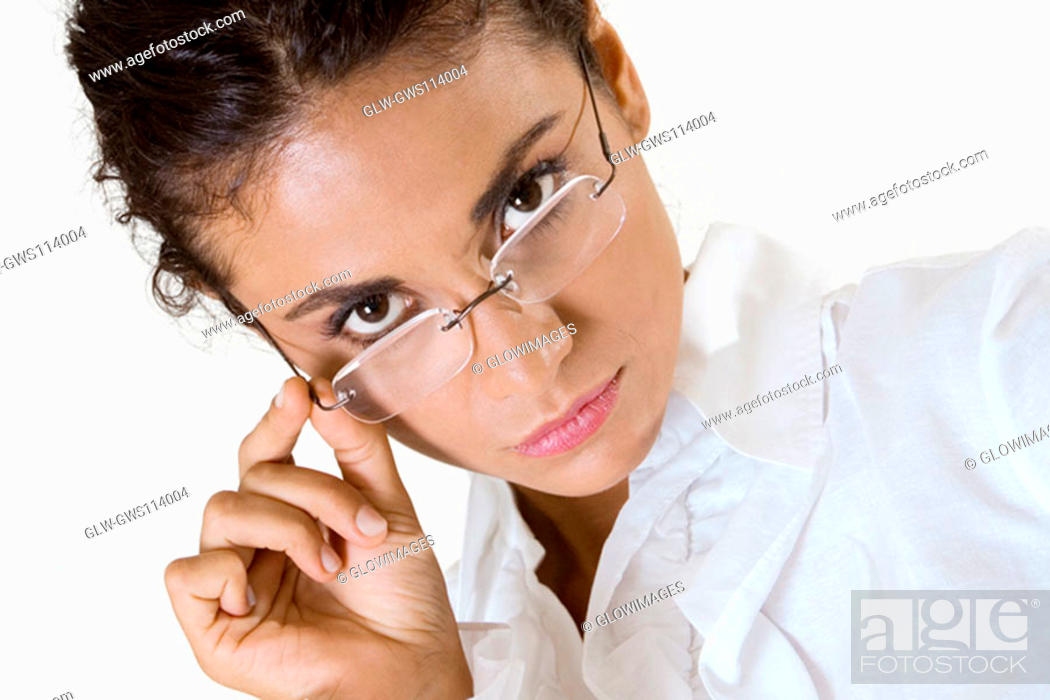 Stock Photo: Portrait of a young woman wearing eyeglasses.