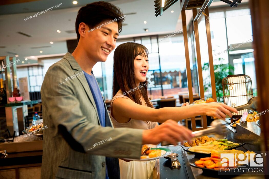 Stock Photo: Young couples in the buffet.