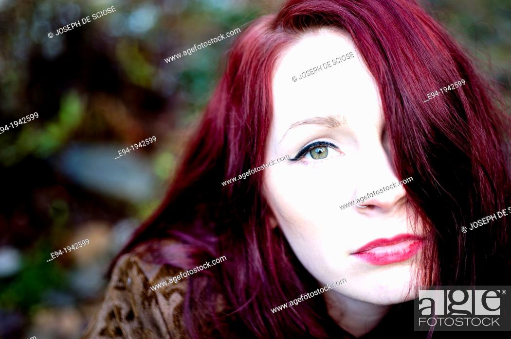Photo de stock: Portrait of a 24 year old red headed woman outdoors.
