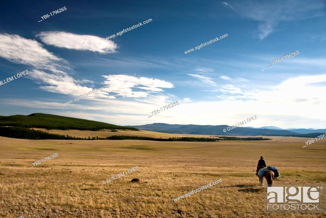 Stock Photo: Nomad rider in the steppes of Northern Mongolia.