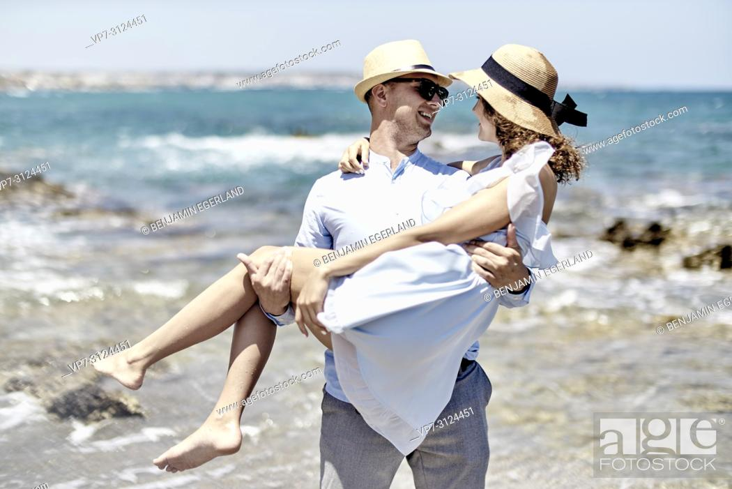Stock Photo: lovers, man carrying woman at beach, couple, vacations, summer, flirt.