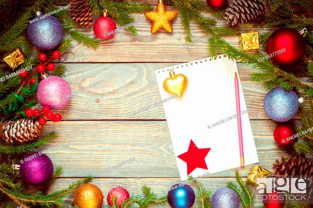 Stock Photo: Christmas tree with decoration on a wooden board. Christmas toy. New year. Sheet for congratulations.