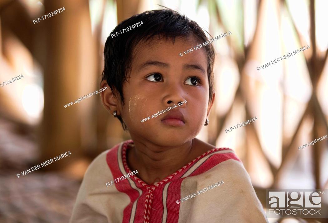 Stock Photo: Close up portrait of Burmese child of the Bamar tribe in Kayin village near Hpa-an, Kayin State / Karen State, Myanmar / Burma.