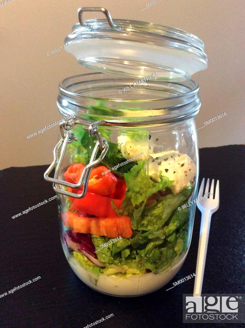 Stock Photo: Salad in a jar. A quick and portable healthy lunch in the go.