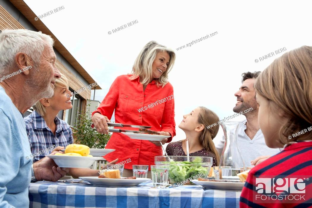 Stock Photo: Germany, Bavaria, Nuremberg, Family barbecue in garden.