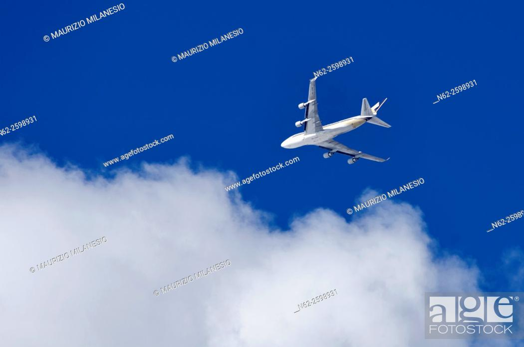 Stock Photo: An airplane, airbus, flying in the sky-blue, to the clouds.