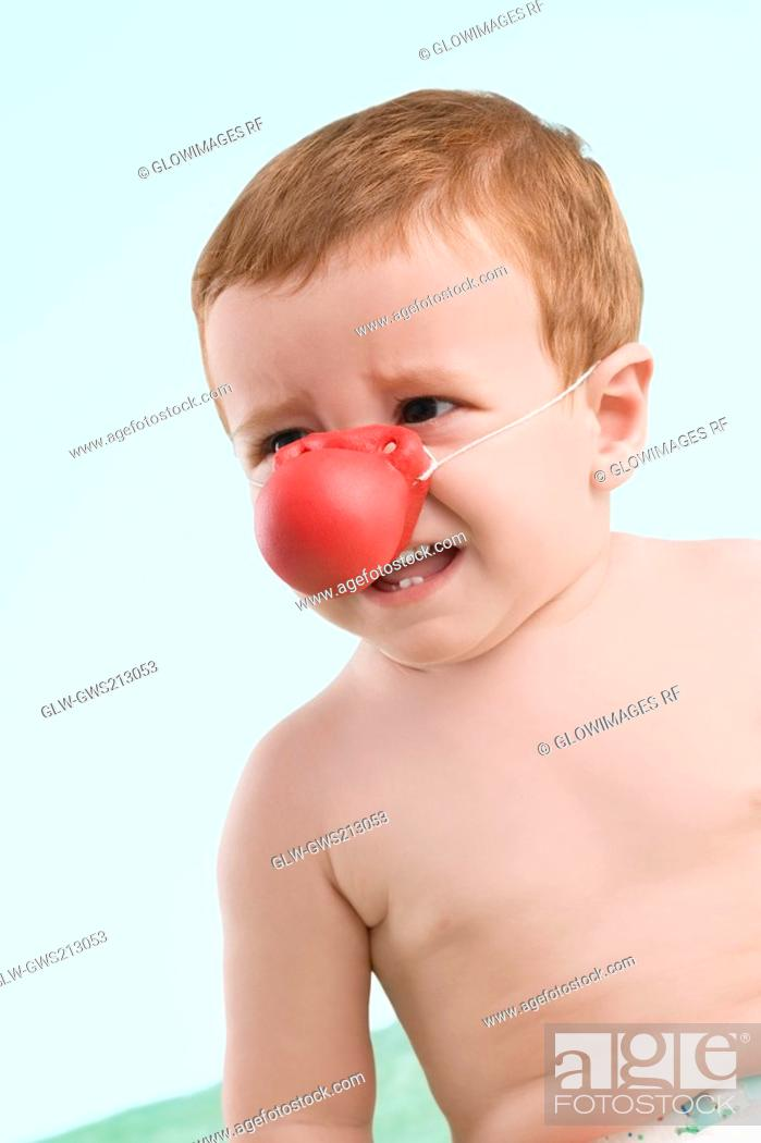 Stock Photo: Close-up of a boy crying.