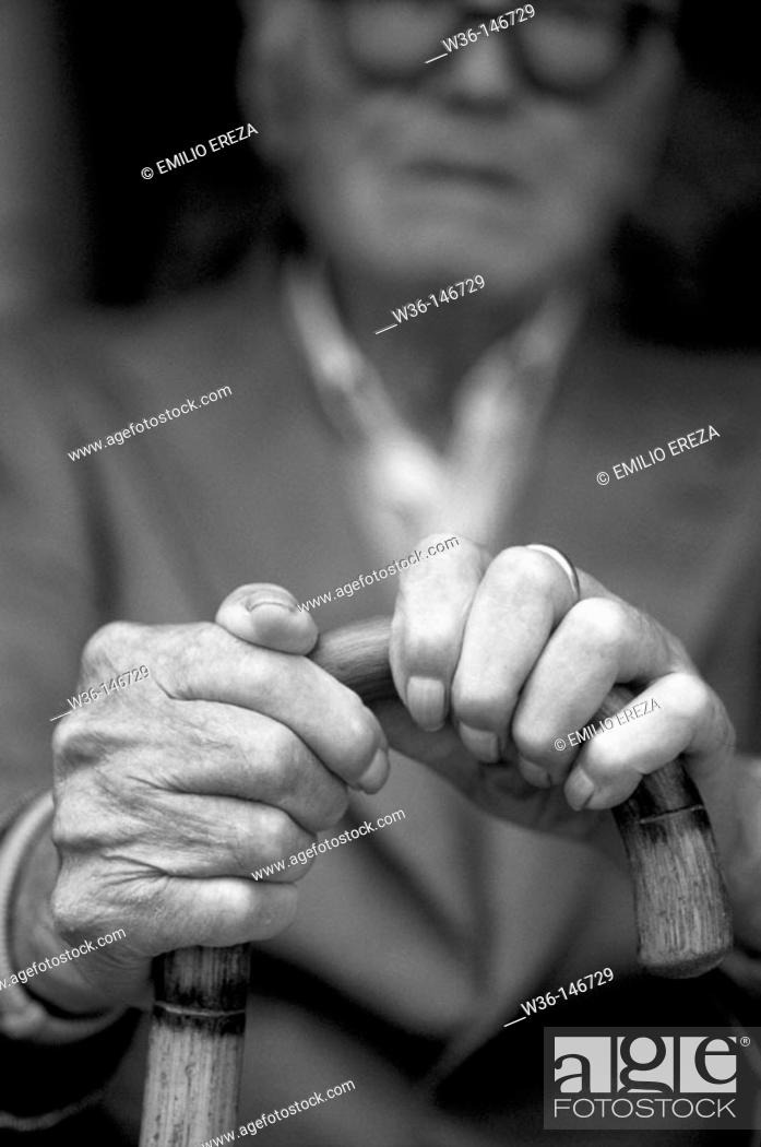 Stock Photo: Elderly man with a walking stick.
