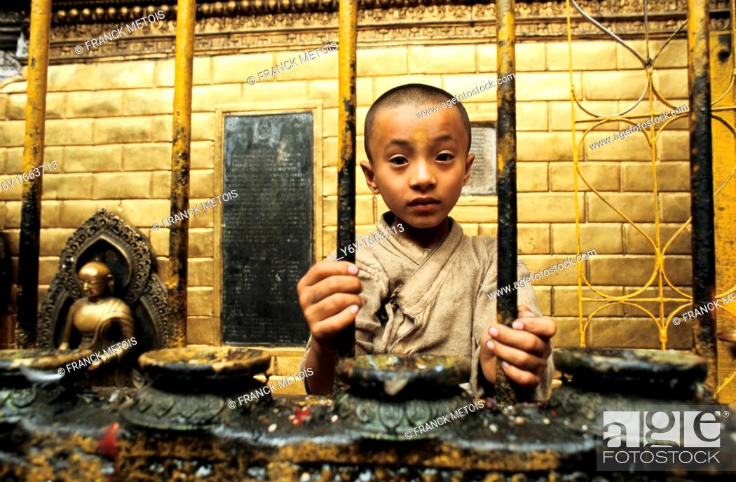 Stock Photo: Boy working as a priest in the Golden temple at Patan  Nepal  It's a tradition among Newars, the original inhabitants of the Kathmandu valley  Every month.