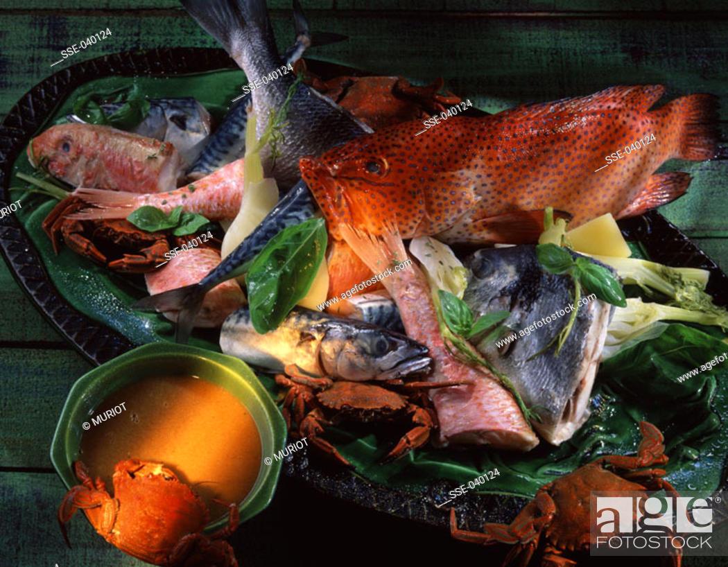 Stock Photo: Bouillabaisse fish soup and fresh fish.