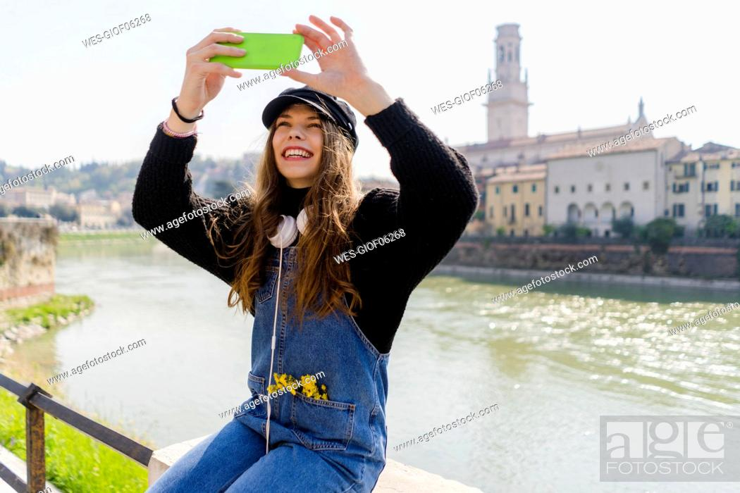 Stock Photo: Young woman using smartphone in Verona.