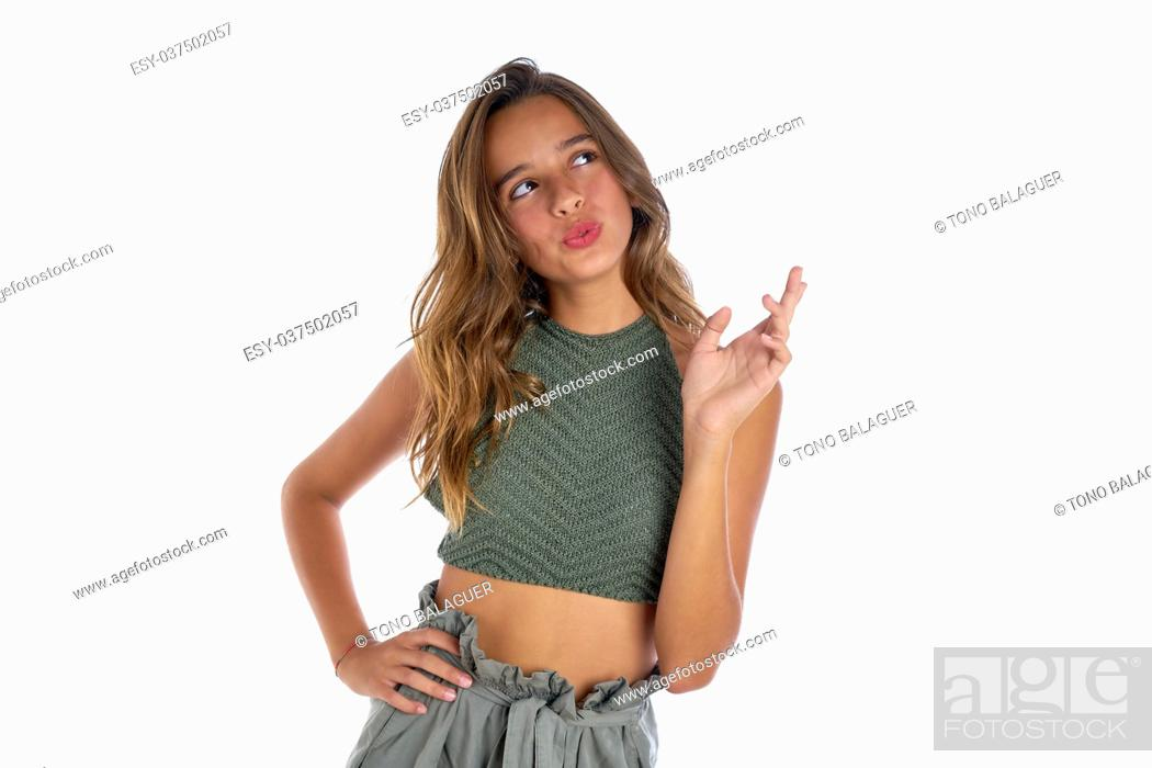 Photo de stock: Brunette teenager girl portrait funny gesture on white background.