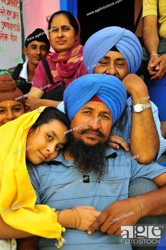 Stock Photo: Sikh pilgrimage family in Gurudwara Temple in Manikaran.