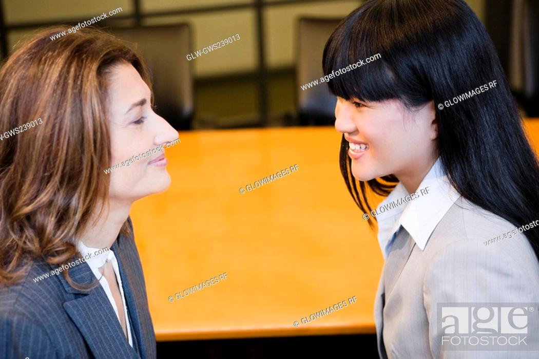 Stock Photo: Close-up of two businesswomen smiling.