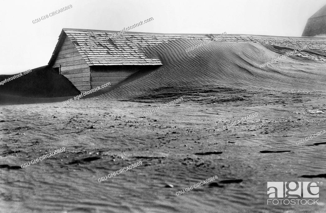 Stock Photo: Soil Drifting over Hog House, South Dakota, USA, Rosebud Photo, Farm Security Administration, 1935.