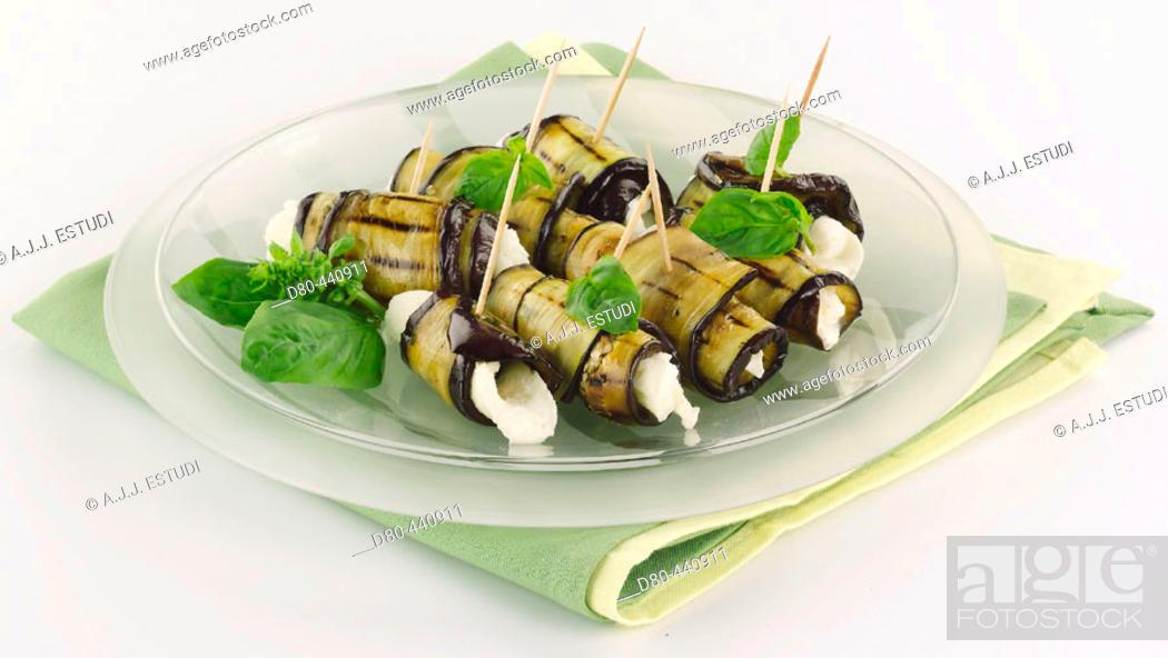 Stock Photo: Rolls of aubergine and mozzarella with origan.