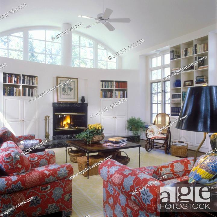 Stock Photo Family Rooms View To Wall With Built In Fireplace And White Cabinets Curved Windows Above Sofa Chairs Foreground Dark