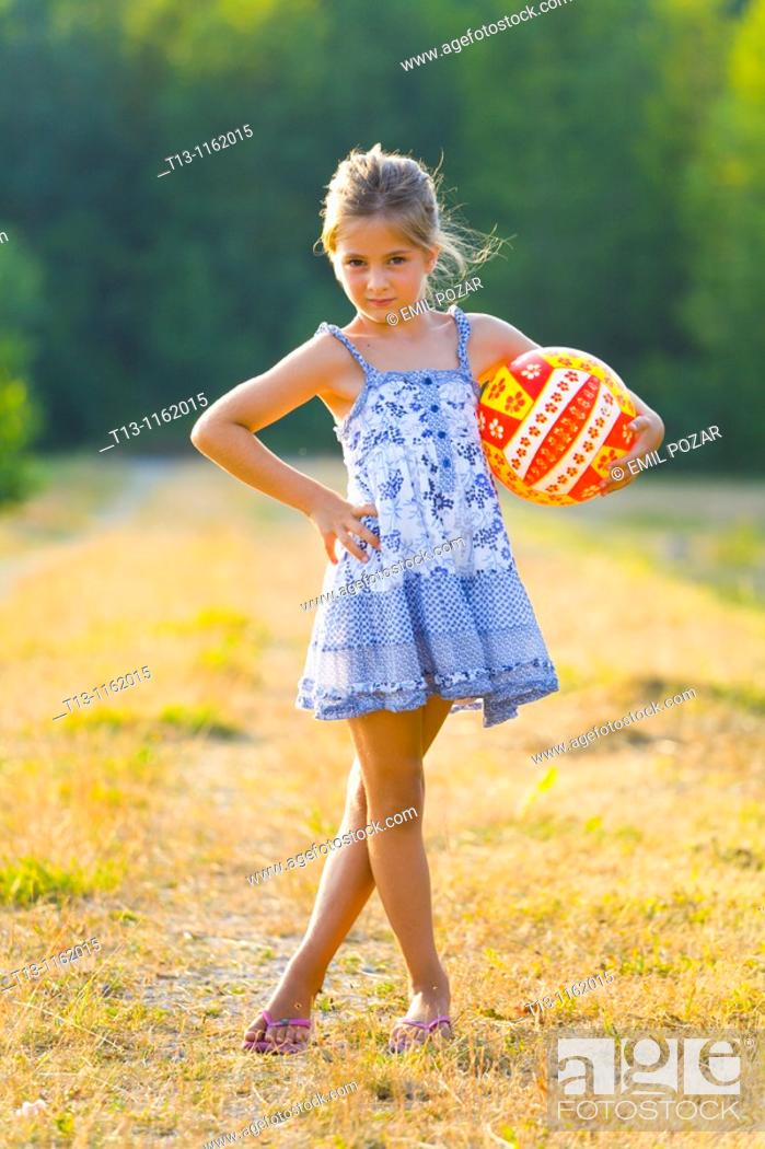 Stock Photo: Posing with a ball in hand 6 years old girl.