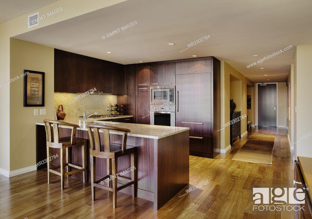 Stock Photo: Wooden cupboards in modern kitchen.