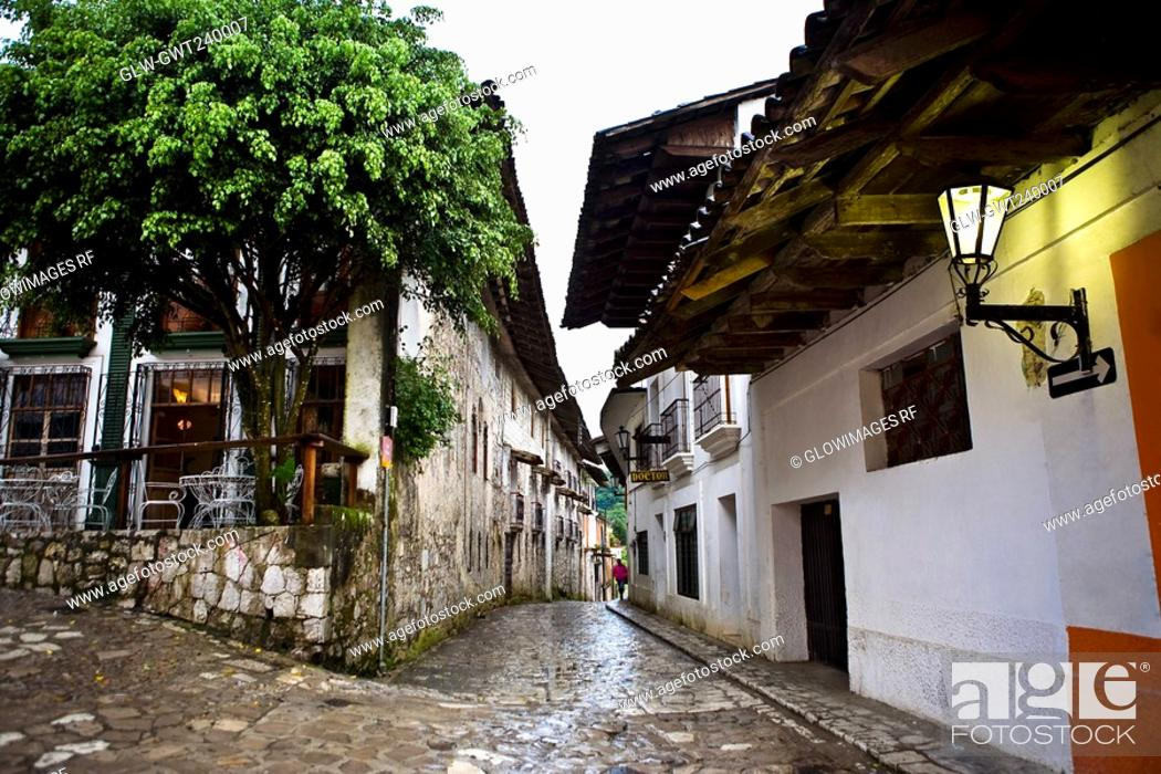 Stock Photo: Buildings on both sides of a street, Cuetzalan, Puebla State, Mexico.