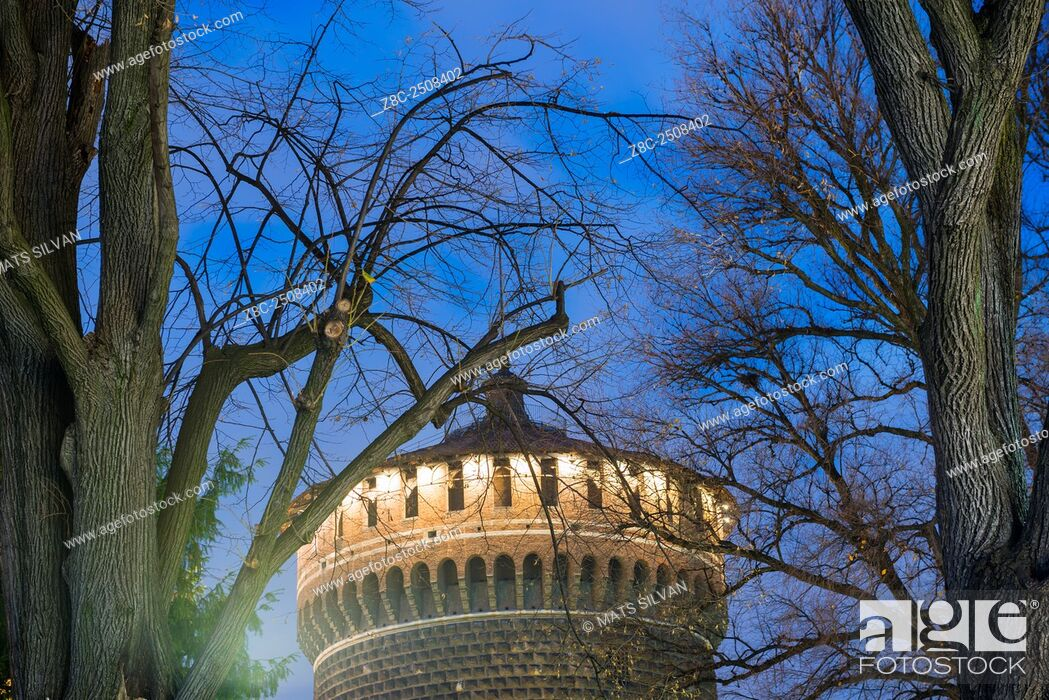 Stock Photo: Sforza castle tower with branches in blue hour in Milan, Italy.