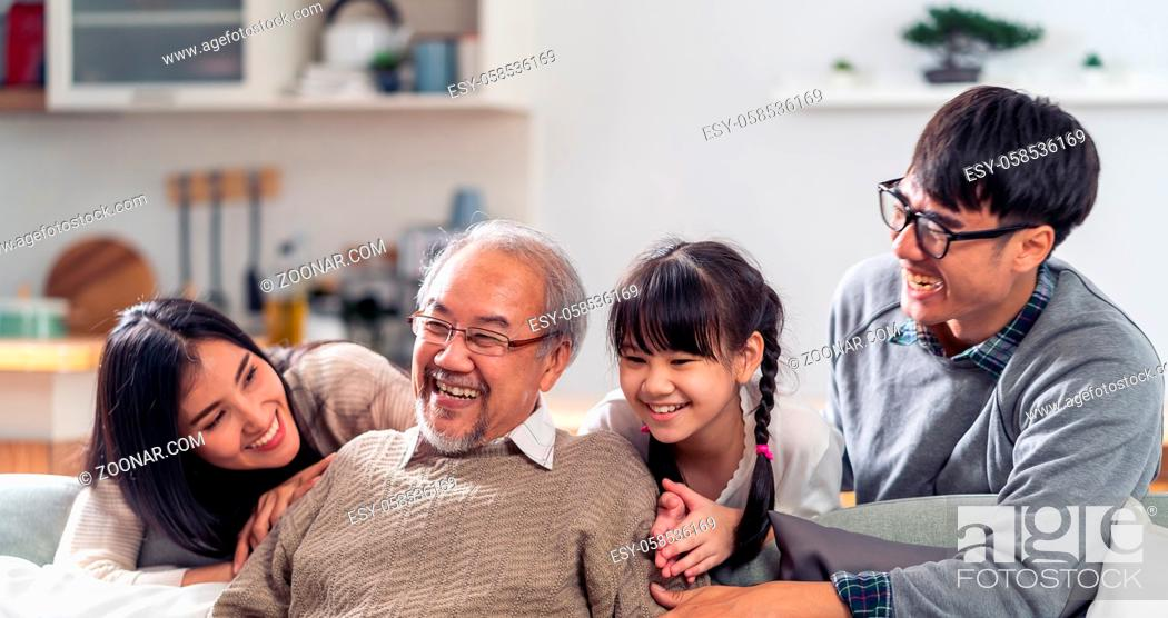 Photo de stock: Panorama Group Portrait of Happy multigenerational asian family sit on sofa couch in living room with smile. Muti genration family happiness concept.