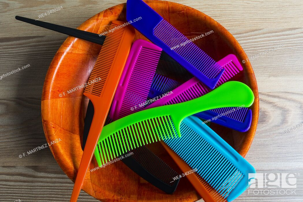Stock Photo: Colorful combs in wooden bowl.