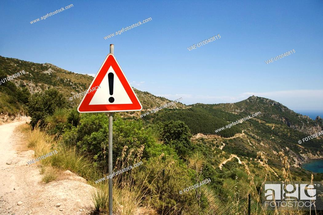 Stock Photo: Caution sign on coastal dirt road.