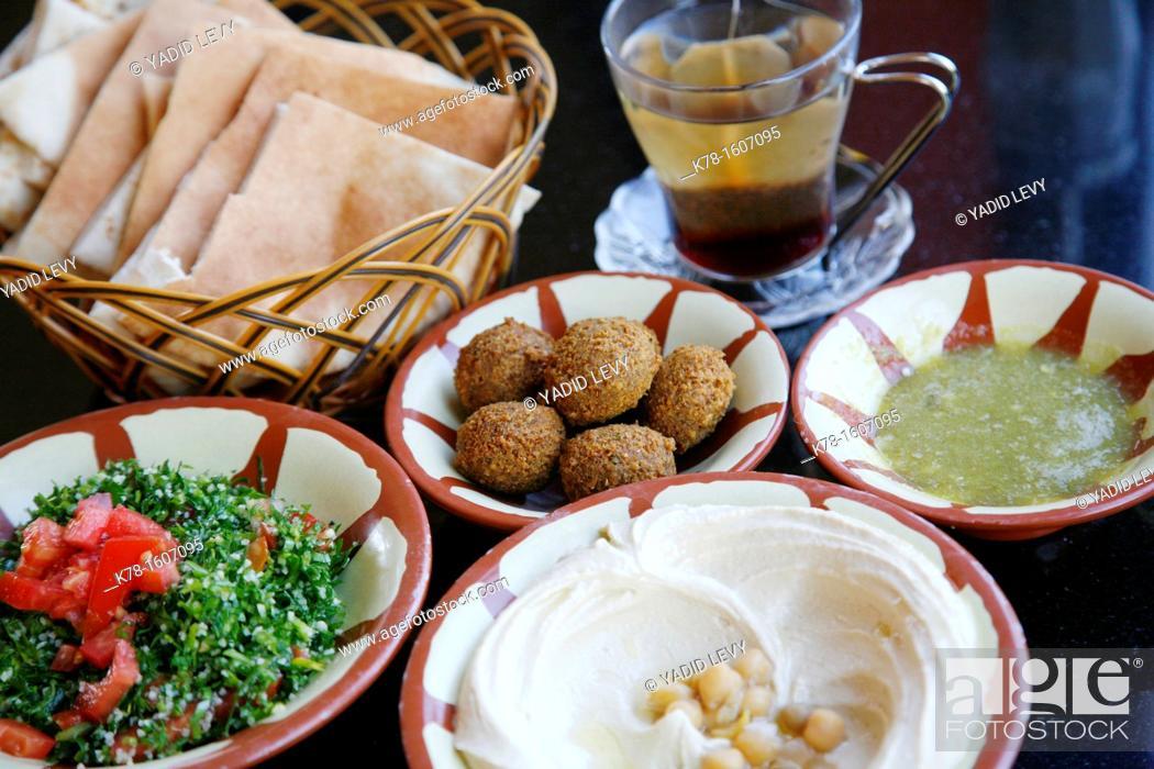 Stock Photo: Typical breakfast of hummus, falafel salad and pita bread, Aqaba, Jordan.