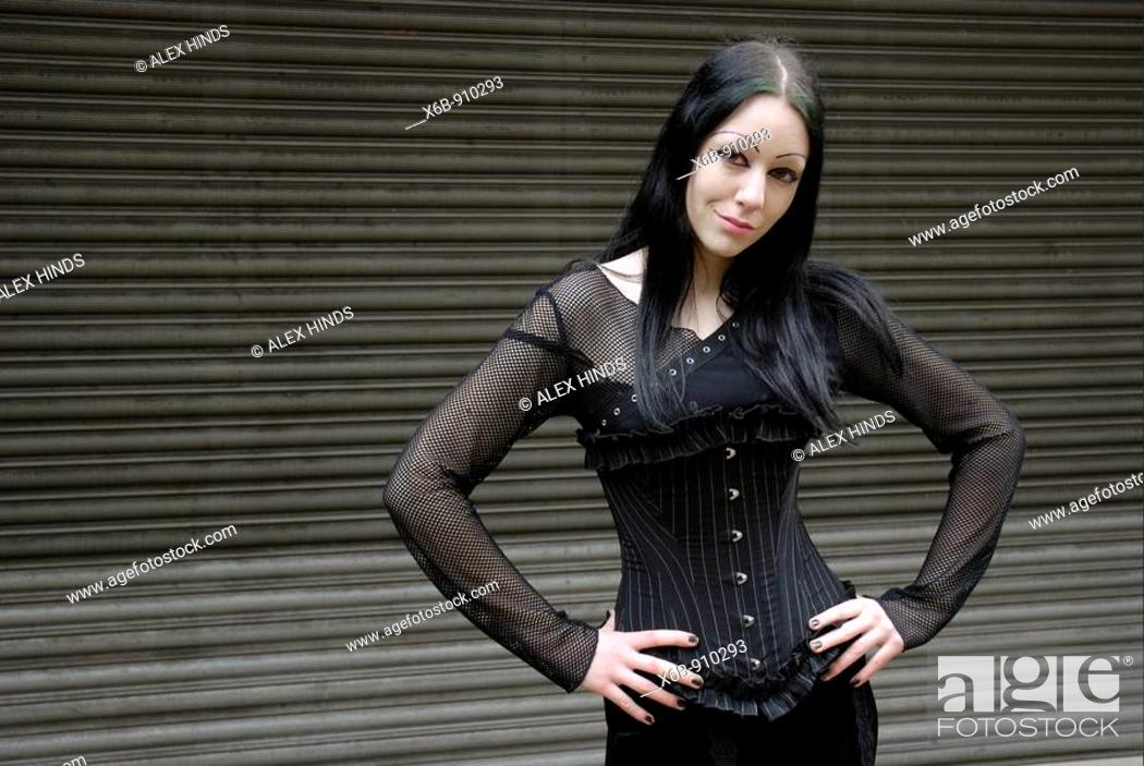 Stock Photo: Teenage gothic girl with a strong attitude.